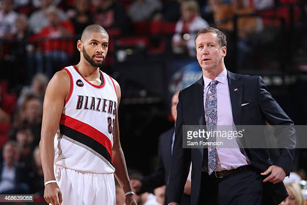 Nicolas Batum and head coach Terry Stotts of the Portland Trail Blazers during the game on April 4 2015 at Moda Center in Portland Oregon NOTE TO...