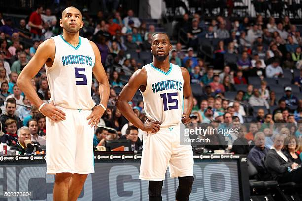 Nicolas Batum and Kemba Walker of the Charlotte Hornets look on during the game against the Boston Celtics on December 23 2015 at Time Warner Cable...