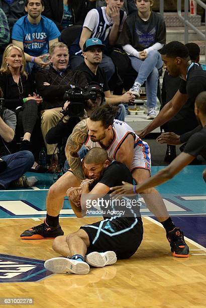 Nicolas Batum of Charlotte Hornets in action against Steven Adams of Oklahoma City Thunder during the NBA match between Oklahoma City Thunder vs...