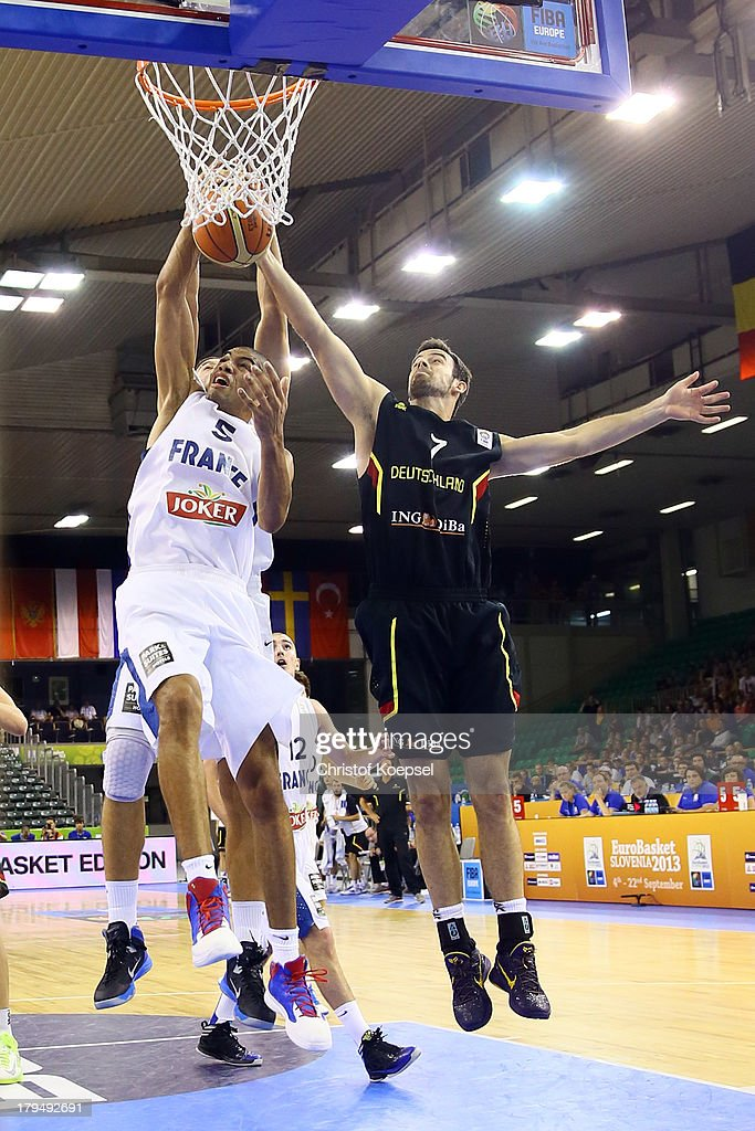 Nicolas Batum of France and Philip Zwiener of Gemany fight for the ball during the FIBA European Championships 2013 first round group A match between France and Germany at Tivoli Arena on September 4, 2013 in Ljubljana, Slovenia.