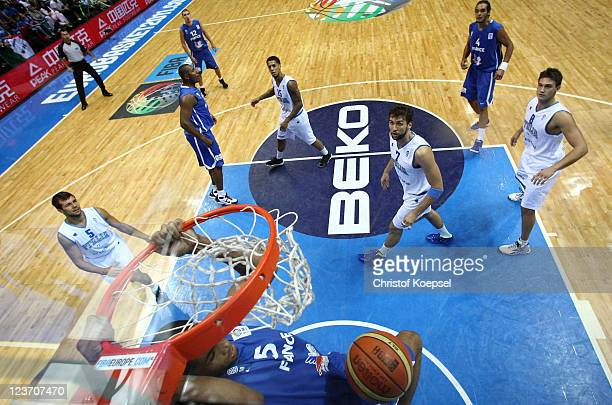 Nicolas Batum of France dunsk the ball during the EuroBasket 2011 first round group B match between Italy and France at Siauliai Arena on September 4...
