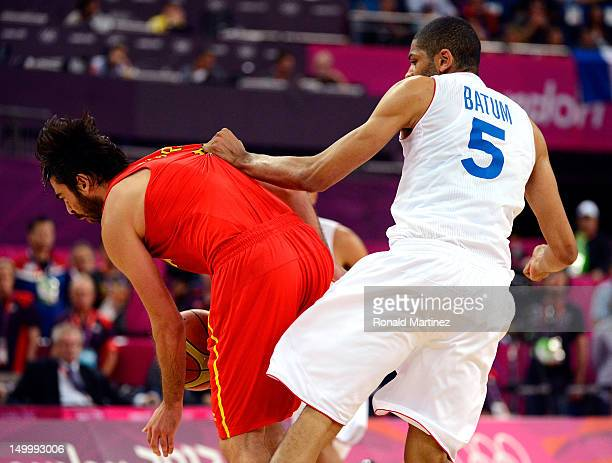 Nicolas Batum of France fouls JuanCarlos Navarro of Spain late in the fourth quarter during the Men's Basketball quaterfinal game on Day 12 of the...