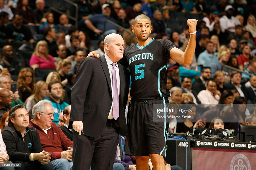 Nicolas Batum of the Charlotte Hornets consults with head coach Steve Clifford during the game against the Miami Heat at the Time Warner Cable Arena...