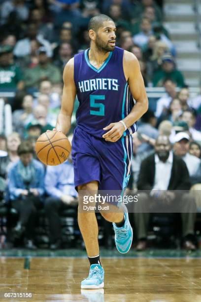 Nicolas Batum of the Charlotte Hornets dribbles the ball in the third quarter against the Milwaukee Bucks at BMO Harris Bradley Center on April 10...