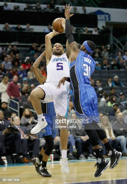 Nicolas Batum of the Charlotte Hornets drives to the basket against Terrence Ross of the Orlando Magic during their game at Spectrum Center on March...