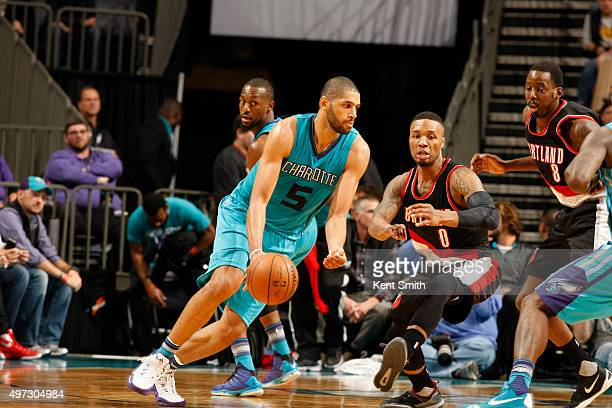 Nicolas Batum of the Charlotte Hornets handles the ball against the Charlotte Hornets on November 15 2015 at Time Warner Cable Arena in Charlotte...
