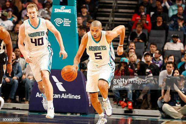 Nicolas Batum of the Charlotte Hornets handles the ball against the Miami Heat on December 9 2015 at Time Warner Cable Arena in Charlotte North...