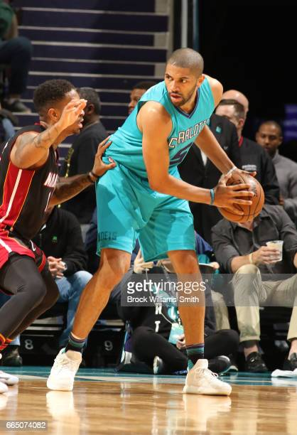 Nicolas Batum of the Charlotte Hornets handles the ball against the Miami Heat during the game on April 5 2017 at Spectrum Center in Charlotte North...
