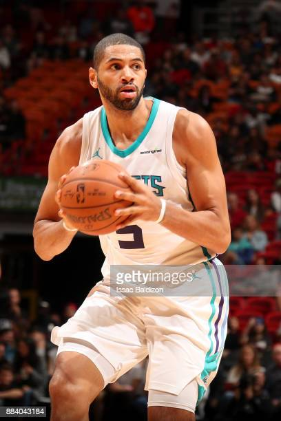 Nicolas Batum of the Charlotte Hornets handles the ball against the Miami Heat on December 1 2017 at American Airlines Arena in Miami Florida NOTE TO...