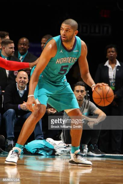 Nicolas Batum of the Charlotte Hornets handles the ball against the Chicago Bulls on December 8 2017 at Spectrum Center in Charlotte North Carolina...
