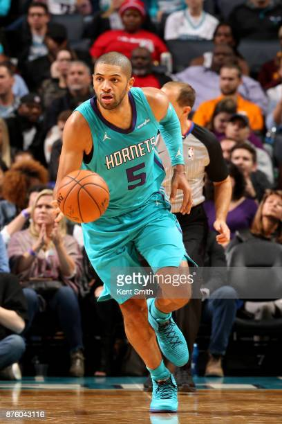 Nicolas Batum of the Charlotte Hornets handles the ball during the game against the LA Clippers on November 18 2017 at Spectrum Center in Charlotte...