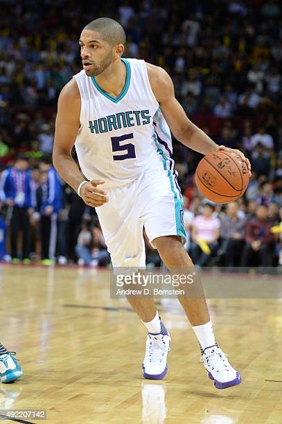 Nicolas Batum of the Charlotte Hornets handles the basketball during a game against the Los Angeles Clippers as part of the 2015 NBA Global Games...