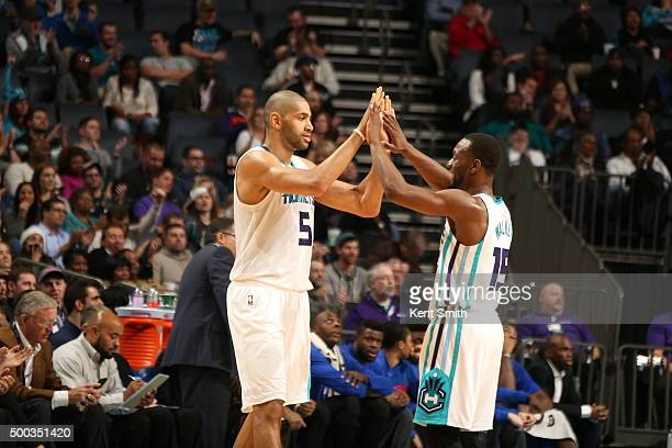 Nicolas Batum of the Charlotte Hornets high fives Kemba Walker of the Charlotte Hornets on December 7 2015 at Time Warner Cable Arena in Charlotte...