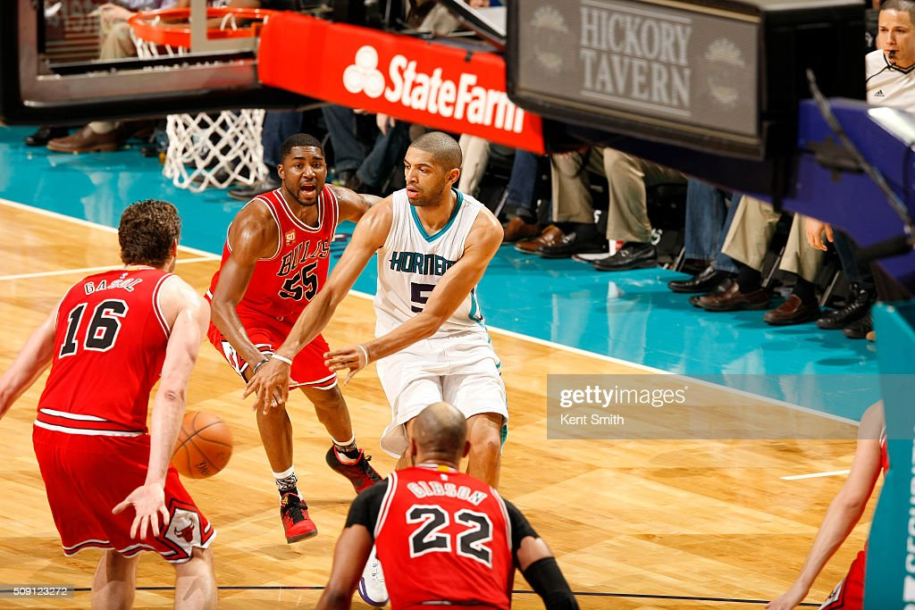<a gi-track='captionPersonalityLinkClicked' href=/galleries/search?phrase=Nicolas+Batum&family=editorial&specificpeople=3746275 ng-click='$event.stopPropagation()'>Nicolas Batum</a> #5 of the Charlotte Hornets on the pass against <a gi-track='captionPersonalityLinkClicked' href=/galleries/search?phrase=Pau+Gasol&family=editorial&specificpeople=201587 ng-click='$event.stopPropagation()'>Pau Gasol</a> #16 of the Chicago Bulls during the game at the Time Warner Cable Arena on February 06, 2016 in Charlotte, North Carolina.