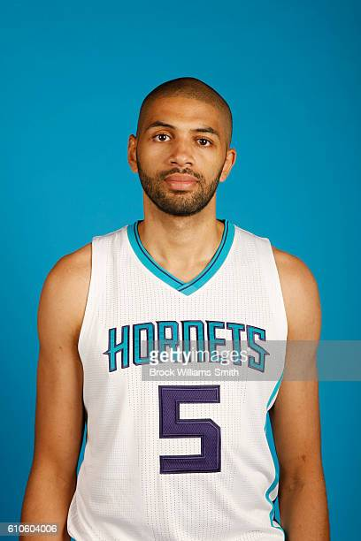 Nicolas Batum of the Charlotte Hornets poses for a head shot during the 20162017 Charlotte Hornets Media Day at the Time Warner Cable Arena on...