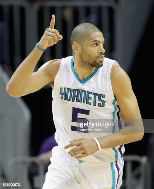 Nicolas Batum of the Charlotte Hornets reacts after a play during their game against the Orlando Magic at Spectrum Center on March 10 2017 in...