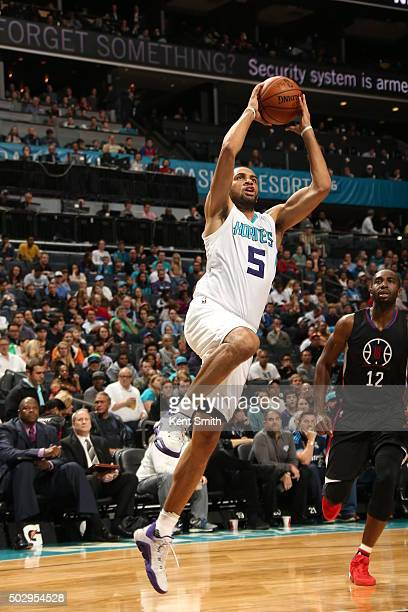 Nicolas Batum of the Charlotte Hornets shoots the ball against the Los Angeles Clippers on December 30 2015 at Time Warner Cable Arena in Charlotte...
