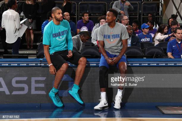 Nicolas Batum of the Charlotte Hornets talks with Frank Ntilikina of the New York Knicks before the game on November 7 2017 at Madison Square Garden...