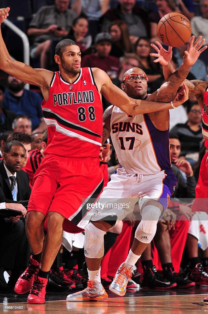 Nicolas Batum #88 of the Portland Trail Blazers and P.J. Tucker #17 of the Phoenix Suns battle for a loose ball on November 21, 2012 at U.S. Airways Center in Phoenix, Arizona.
