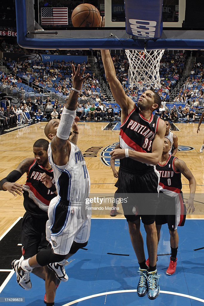 Nicolas Batum #88 of the Portland Trail Blazers blocks a shot attempt by Jameer Nelson #14 the Orlando Magic during the game on February 10, 2013 at Amway Center in Orlando, Florida.