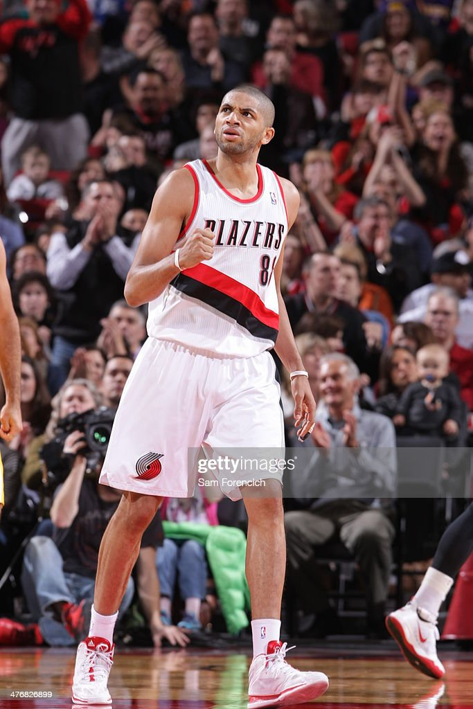 <a gi-track='captionPersonalityLinkClicked' href=/galleries/search?phrase=Nicolas+Batum&family=editorial&specificpeople=3746275 ng-click='$event.stopPropagation()'>Nicolas Batum</a> #88 of the Portland Trail Blazers celebrates against the Los Angeles Lakers on March 3, 2014 at the Moda Center Arena in Portland, Oregon.