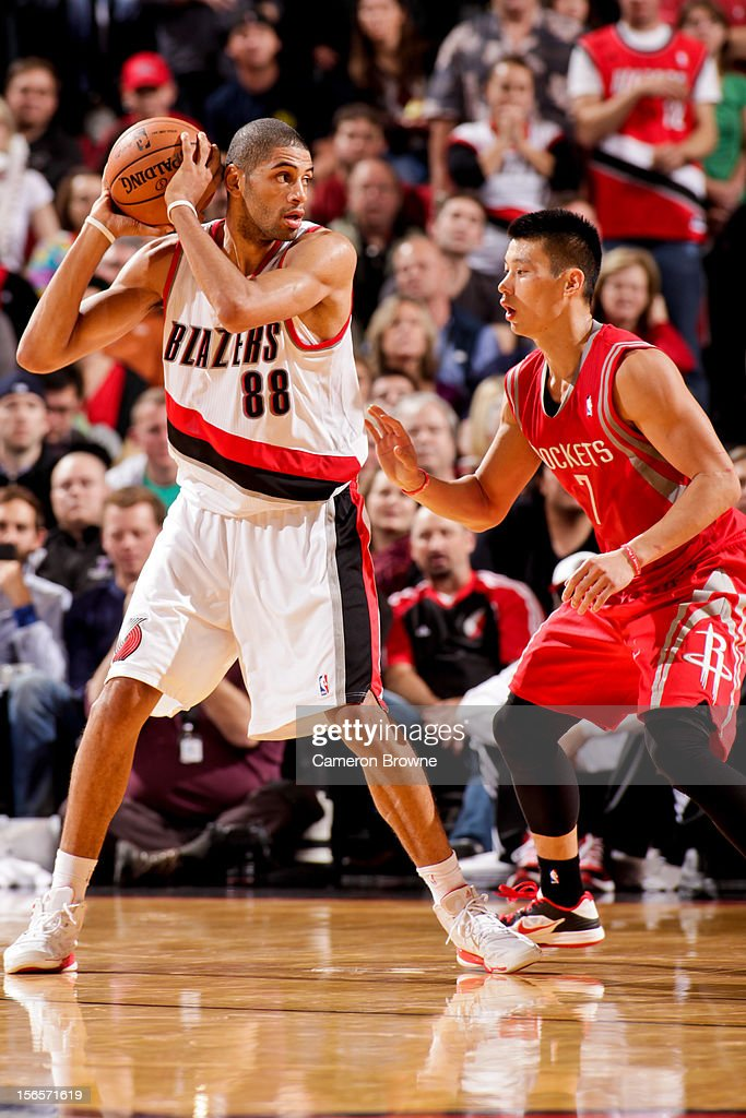 <a gi-track='captionPersonalityLinkClicked' href=/galleries/search?phrase=Nicolas+Batum&family=editorial&specificpeople=3746275 ng-click='$event.stopPropagation()'>Nicolas Batum</a> #88 of the Portland Trail Blazers controls the ball against <a gi-track='captionPersonalityLinkClicked' href=/galleries/search?phrase=Jeremy+Lin&family=editorial&specificpeople=6669516 ng-click='$event.stopPropagation()'>Jeremy Lin</a> #7 of the Houston Rockets on November 16, 2012 at the Rose Garden Arena in Portland, Oregon.