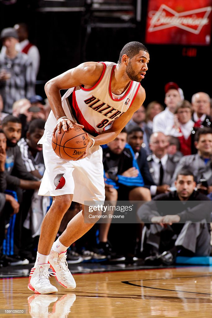 <a gi-track='captionPersonalityLinkClicked' href=/galleries/search?phrase=Nicolas+Batum&family=editorial&specificpeople=3746275 ng-click='$event.stopPropagation()'>Nicolas Batum</a> #88 of the Portland Trail Blazers controls the ball against the Orlando Magic on January 7, 2013 at the Rose Garden Arena in Portland, Oregon.