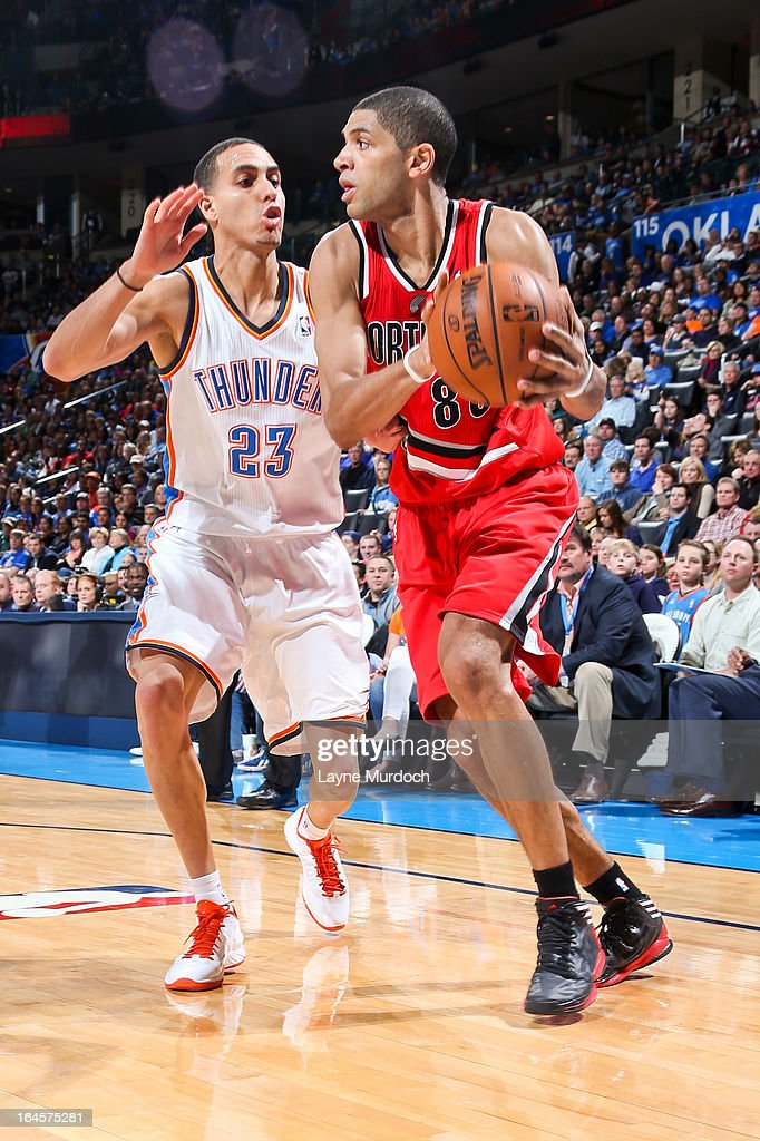 Nicolas Batum #88 of the Portland Trail Blazers controls the ball against Kevin Martin #23 of the Oklahoma City Thunder on March 24, 2013 at the Chesapeake Energy Arena in Oklahoma City, Oklahoma.