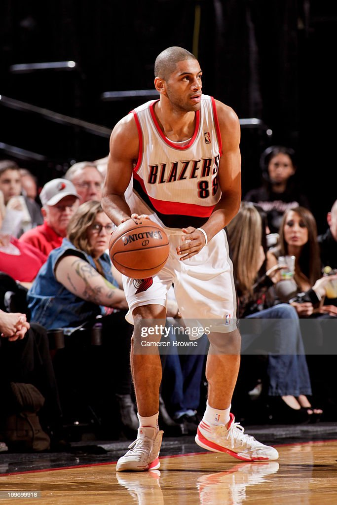 <a gi-track='captionPersonalityLinkClicked' href=/galleries/search?phrase=Nicolas+Batum&family=editorial&specificpeople=3746275 ng-click='$event.stopPropagation()'>Nicolas Batum</a> #88 of the Portland Trail Blazers controls the ball against the Milwaukee Bucks on January 19, 2013 at the Rose Garden Arena in Portland, Oregon.