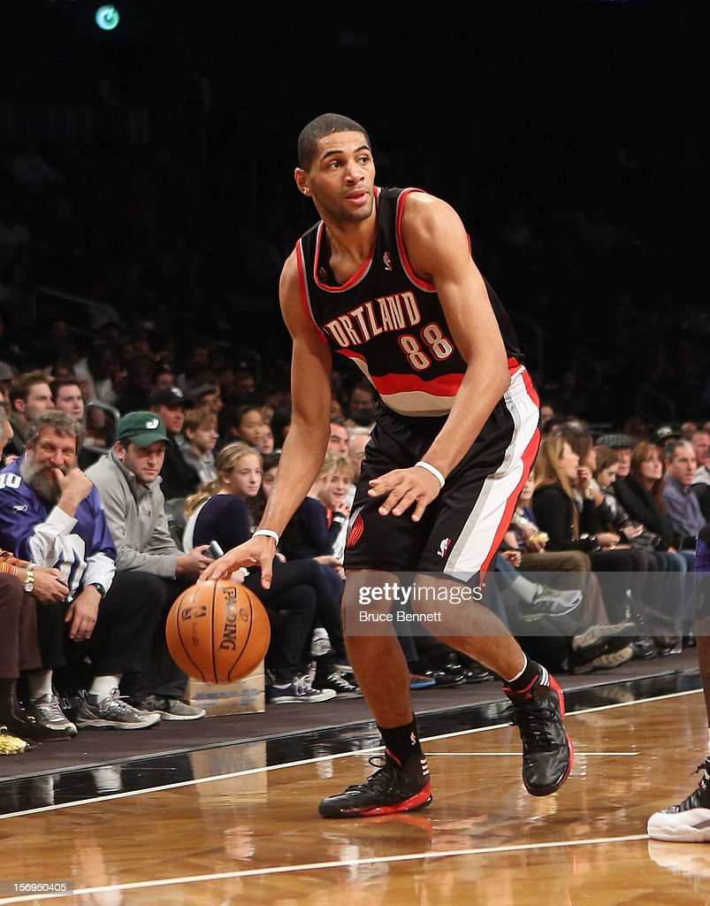Nicolas Batum #88 of the Portland Trail Blazers dribbles the ball against the Brooklyn Nets at the Barclays Center on November 25, 2012 in the Brooklyn borough of New York City.