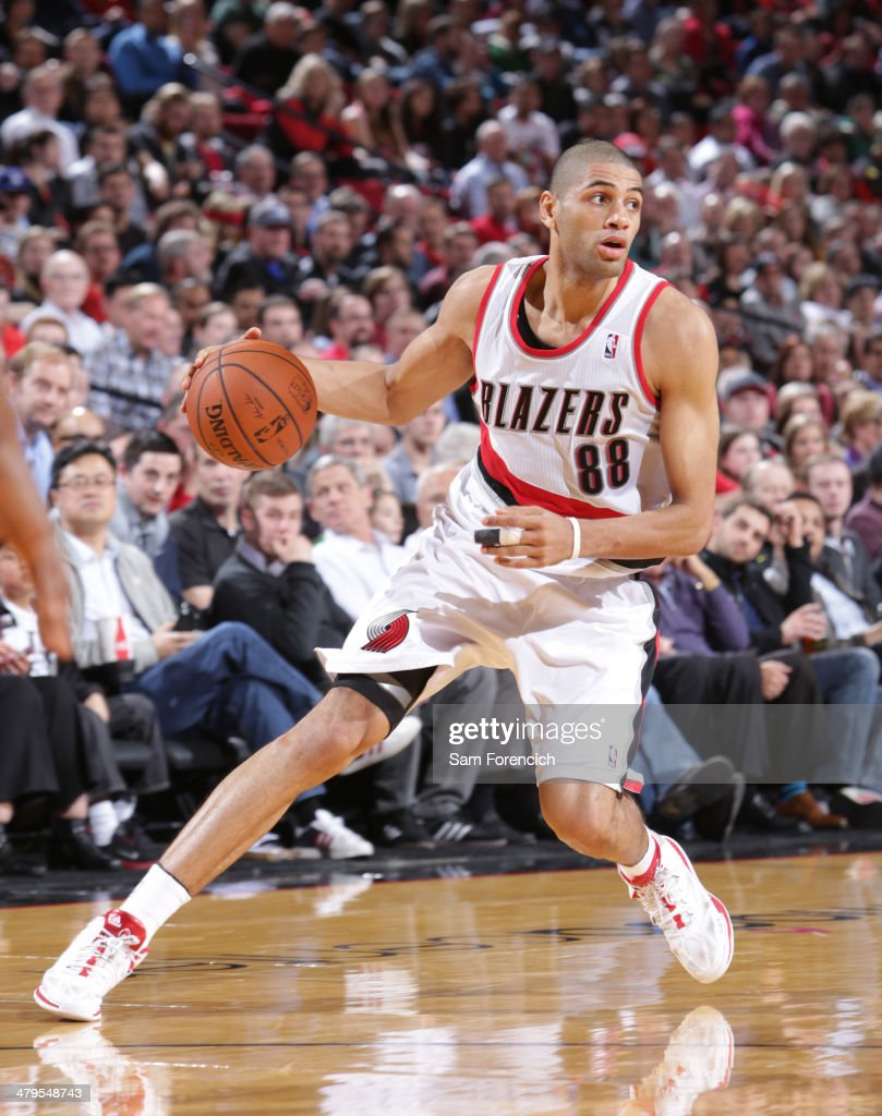 <a gi-track='captionPersonalityLinkClicked' href=/galleries/search?phrase=Nicolas+Batum&family=editorial&specificpeople=3746275 ng-click='$event.stopPropagation()'>Nicolas Batum</a> #88 of the Portland Trail Blazers dribbles the ball against the Milwaukee Bucks on March 18, 2014 at the Moda Center Arena in Portland, Oregon.