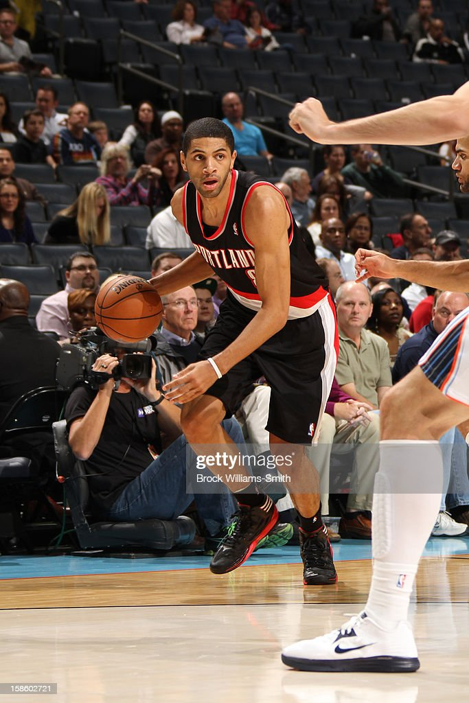 Nicolas Batum #88 of the Portland Trail Blazers dribbles the ball up court against the Charlotte Bobcats at the Time Warner Cable Arena on December 3, 2012 in Charlotte, North Carolina.