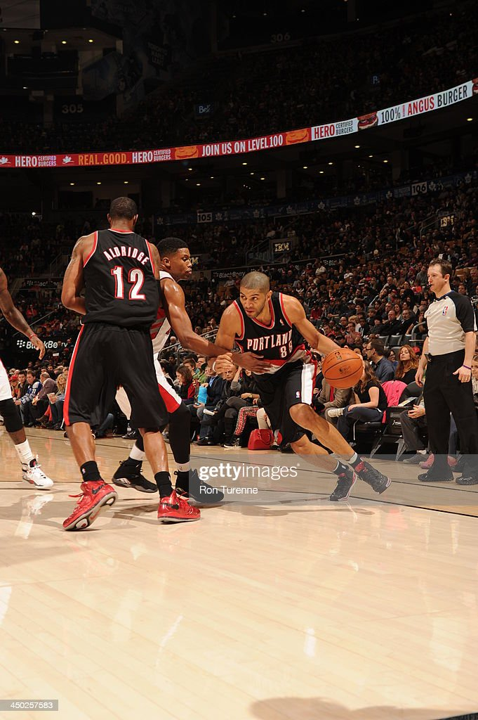 <a gi-track='captionPersonalityLinkClicked' href=/galleries/search?phrase=Nicolas+Batum&family=editorial&specificpeople=3746275 ng-click='$event.stopPropagation()'>Nicolas Batum</a> #88 of the Portland Trail Blazers dribbles to the basket against the Toronto Raptors during the game on November 17, 2013 at the Air Canada Centre in Toronto, Ontario, Canada.