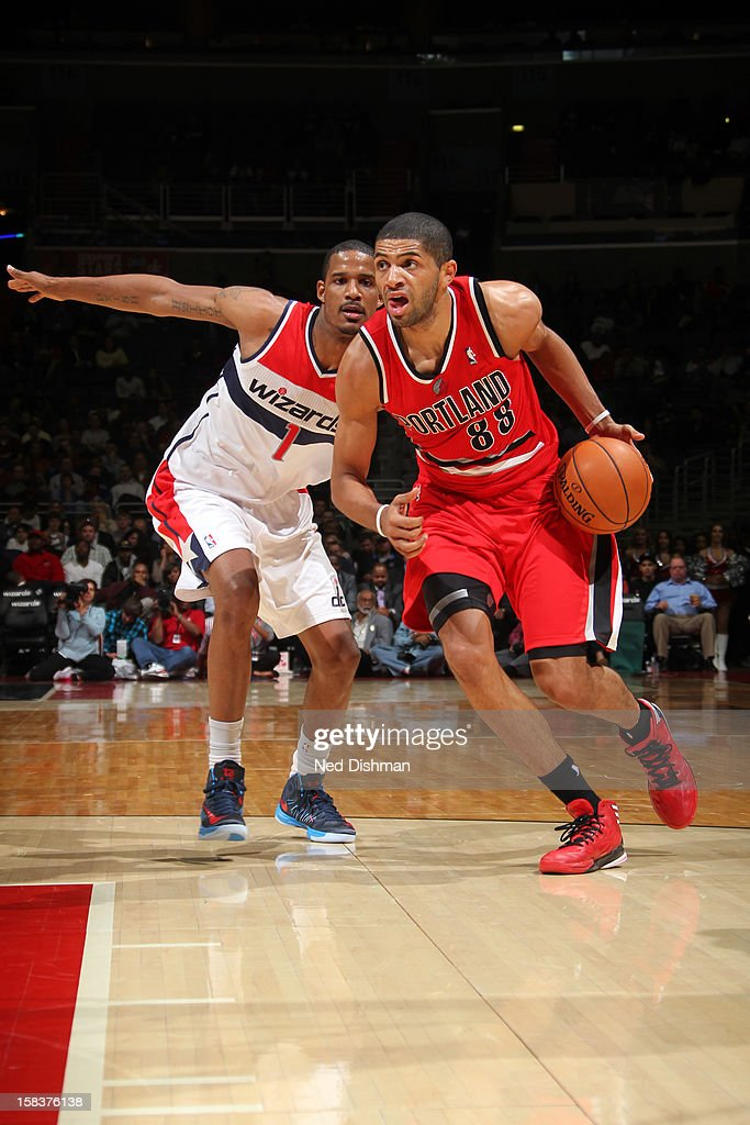 <a gi-track='captionPersonalityLinkClicked' href=/galleries/search?phrase=Nicolas+Batum&family=editorial&specificpeople=3746275 ng-click='$event.stopPropagation()'>Nicolas Batum</a> #88 of the Portland Trail Blazers drives to the basket while guarded by <a gi-track='captionPersonalityLinkClicked' href=/galleries/search?phrase=Trevor+Ariza&family=editorial&specificpeople=201708 ng-click='$event.stopPropagation()'>Trevor Ariza</a> #1 of the Washington Wizards at the Verizon Center on November 28, 2012 in Washington, DC.