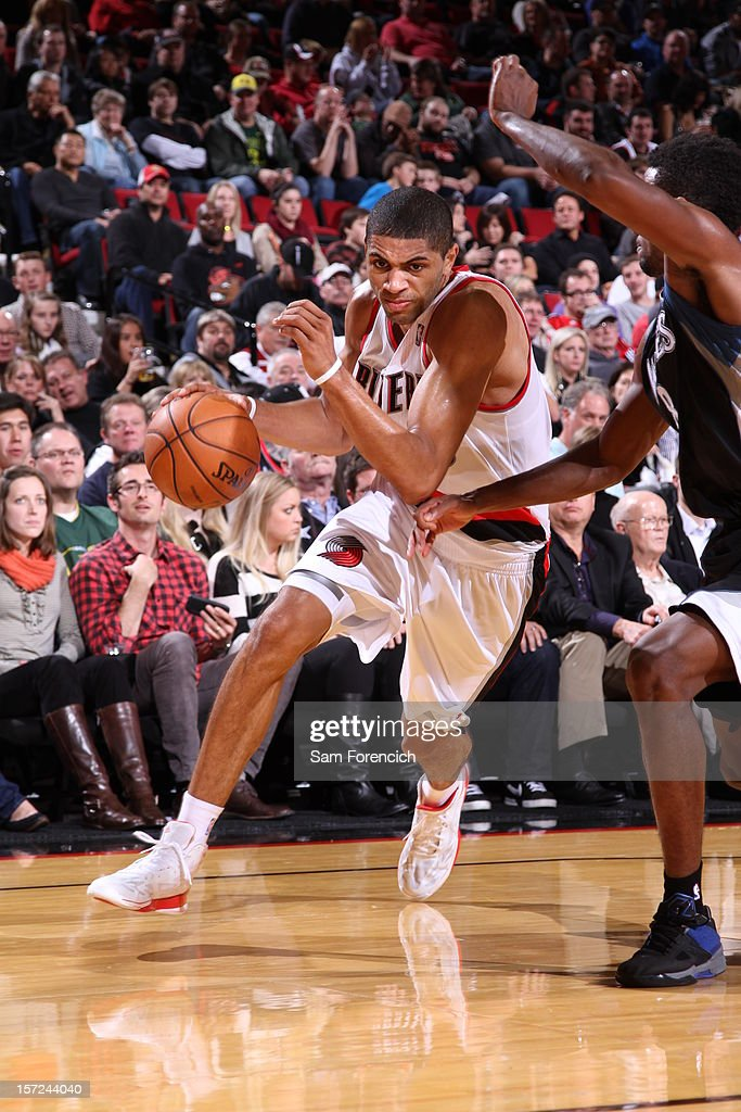 <a gi-track='captionPersonalityLinkClicked' href=/galleries/search?phrase=Nicolas+Batum&family=editorial&specificpeople=3746275 ng-click='$event.stopPropagation()'>Nicolas Batum</a> #88 of the Portland Trail Blazers drives to the basket against Malcolm Lee #8 of the Minnesota Timberwolves on November 23, 2012 at the Rose Garden Arena in Portland, Oregon.