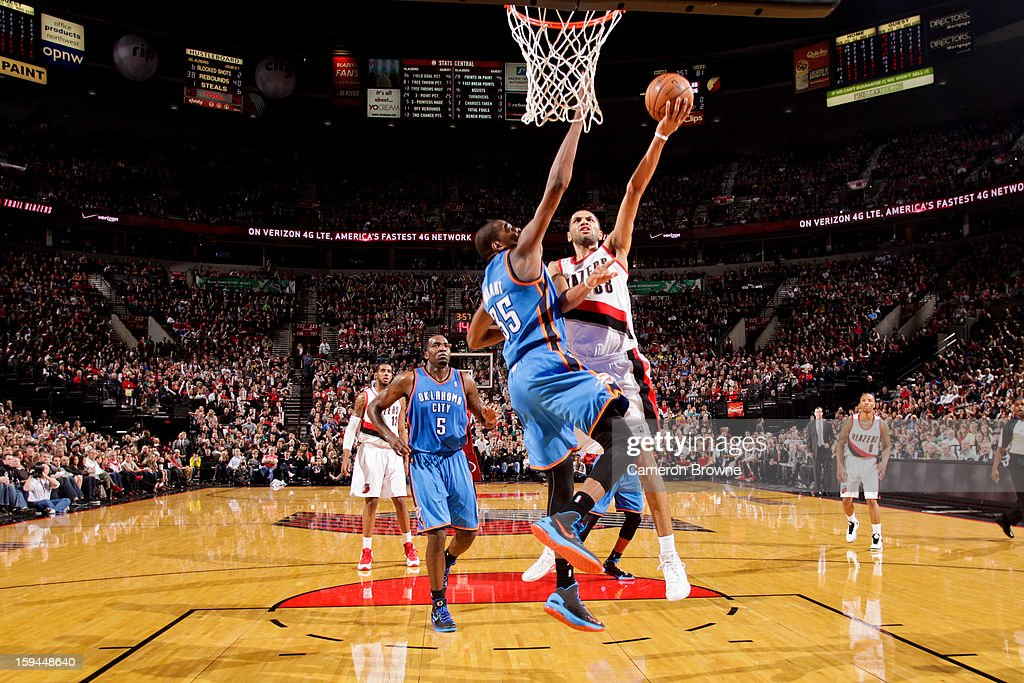 Nicolas Batum #88 of the Portland Trail Blazers drives to the basket against Kevin Durant #35 of the Oklahoma City Thunder on January 13, 2013 at the Rose Garden Arena in Portland, Oregon.