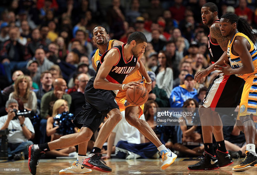 <a gi-track='captionPersonalityLinkClicked' href=/galleries/search?phrase=Nicolas+Batum&family=editorial&specificpeople=3746275 ng-click='$event.stopPropagation()'>Nicolas Batum</a> #88 of the Portland Trail Blazers drives to the basket against <a gi-track='captionPersonalityLinkClicked' href=/galleries/search?phrase=Andre+Iguodala&family=editorial&specificpeople=201980 ng-click='$event.stopPropagation()'>Andre Iguodala</a> #9 of the Denver Nuggets at the Pepsi Center on January 15, 2013 in Denver, Colorado. The Nuggets defeated the Trail Blazers 115-111 in overtime.