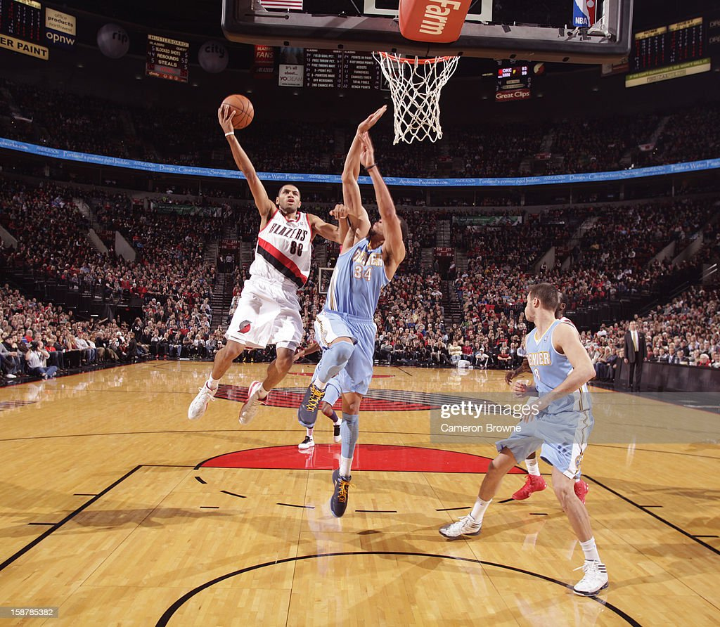 <a gi-track='captionPersonalityLinkClicked' href=/galleries/search?phrase=Nicolas+Batum&family=editorial&specificpeople=3746275 ng-click='$event.stopPropagation()'>Nicolas Batum</a> #88 of the Portland Trail Blazers drives to the basket against the Denver Nuggets on December 20, 2012 at the Rose Garden Arena in Portland, Oregon.