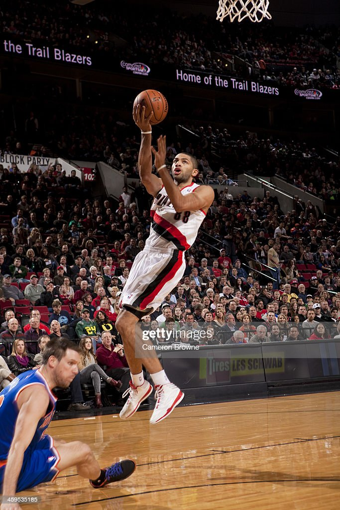 <a gi-track='captionPersonalityLinkClicked' href=/galleries/search?phrase=Nicolas+Batum&family=editorial&specificpeople=3746275 ng-click='$event.stopPropagation()'>Nicolas Batum</a> #88 of the Portland Trail Blazers drives to the basket against the New York Knicks on November 25, 2013 at the Moda Center Arena in Portland, Oregon.