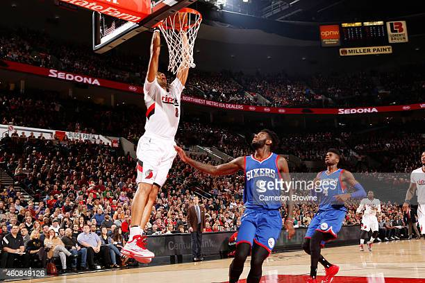 Nicolas Batum of the Portland Trail Blazers dunks against the Philadelphia 76ers during the game on December 26 2014 at the Moda Center Arena in...
