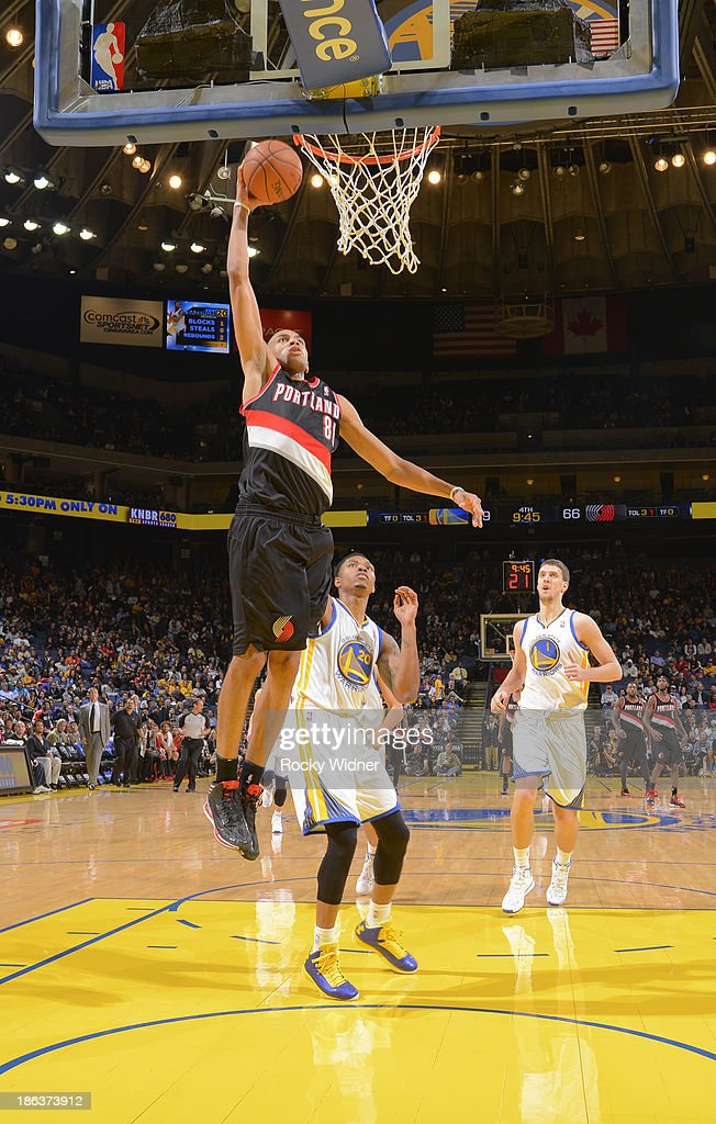 <a gi-track='captionPersonalityLinkClicked' href=/galleries/search?phrase=Nicolas+Batum&family=editorial&specificpeople=3746275 ng-click='$event.stopPropagation()'>Nicolas Batum</a> #88 of the Portland Trail Blazers dunks against the Golden State Warriors on October 24, 2013 at Oracle Arena in Oakland, California.