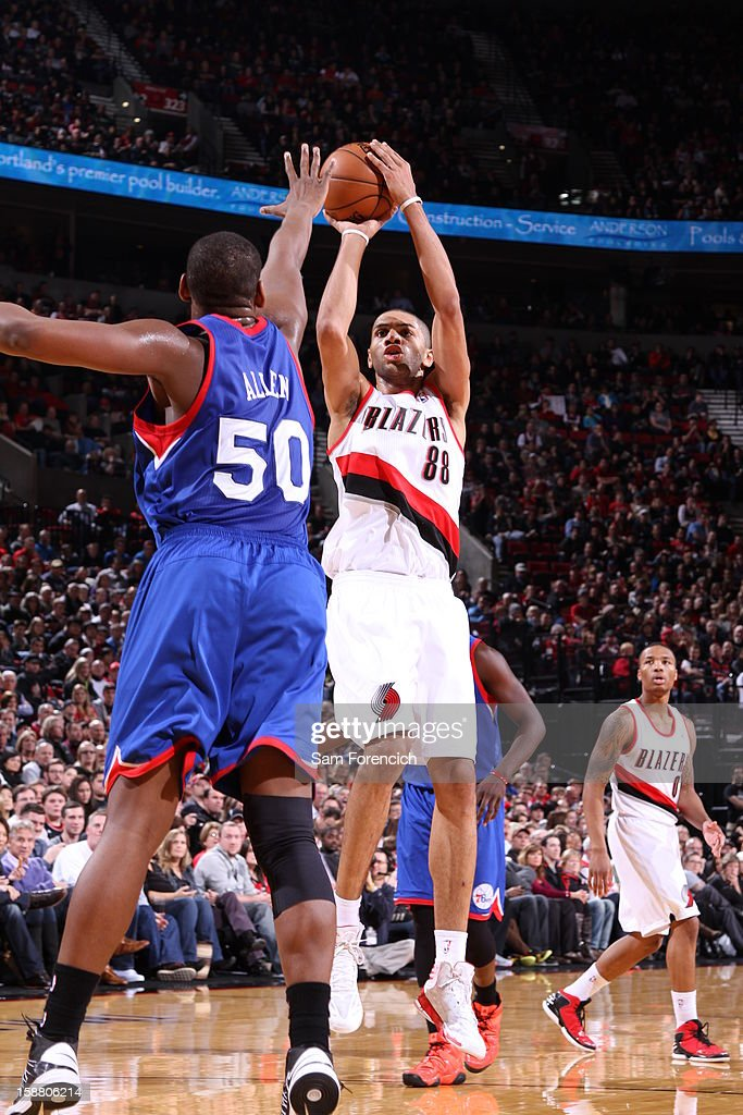 Nicolas Batum #88 of the Portland Trail Blazers goes for a jump shot against Lavoy Allen #50 of the Philadelphia 76ers during the game between the Philadelphia 76ers and the Portland Trail Blazers on December 29, 2012 at the Rose Garden Arena in Portland, Oregon.