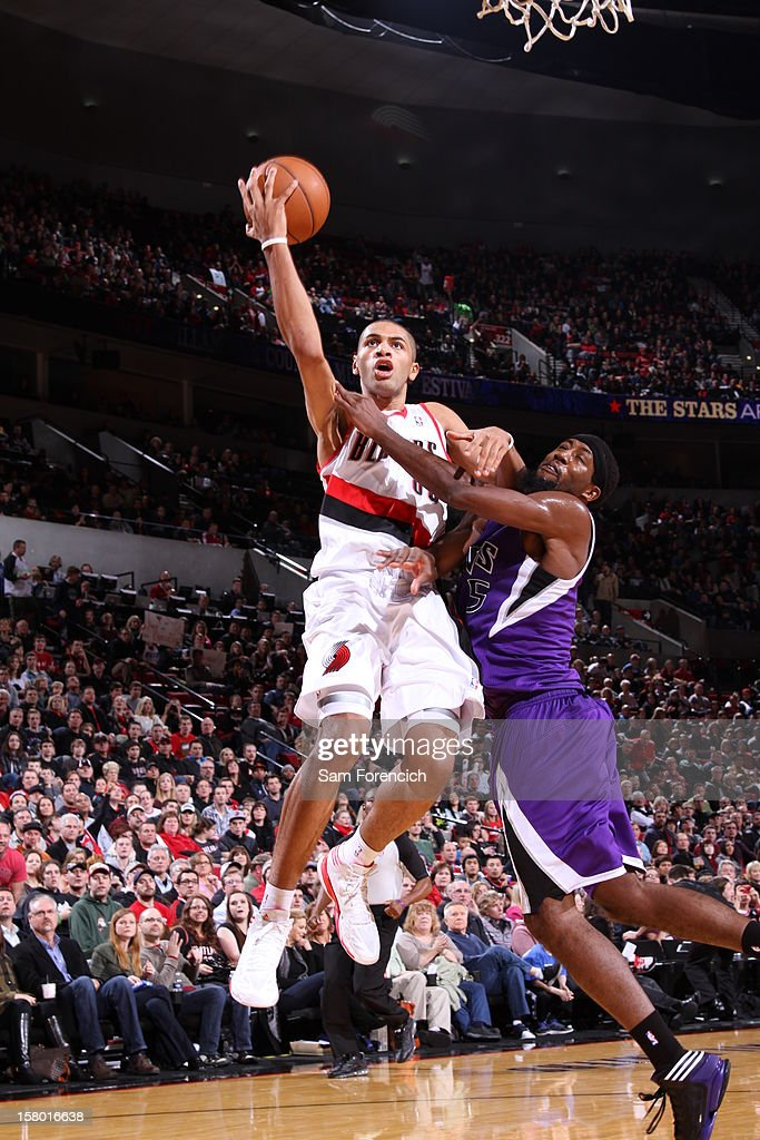 Nicolas Batum #88 of the Portland Trail Blazers goes to the basket against John Salmons #5 of the Sacramento Kings during the game between the Sacramento Kings and the Portland Trail Blazers on December 8, 2012 at the Rose Garden Arena in Portland, Oregon.