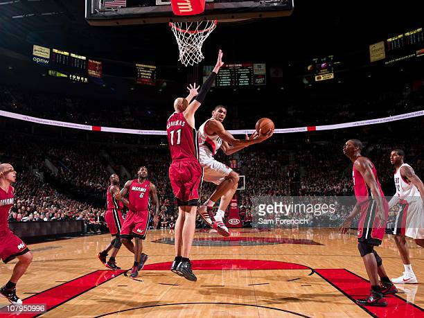Nicolas Batum of the Portland Trail Blazers goes up for a shot against Zydrunas Ilgauskas of Miami Heat during a game on January 9 2011 at the Rose...