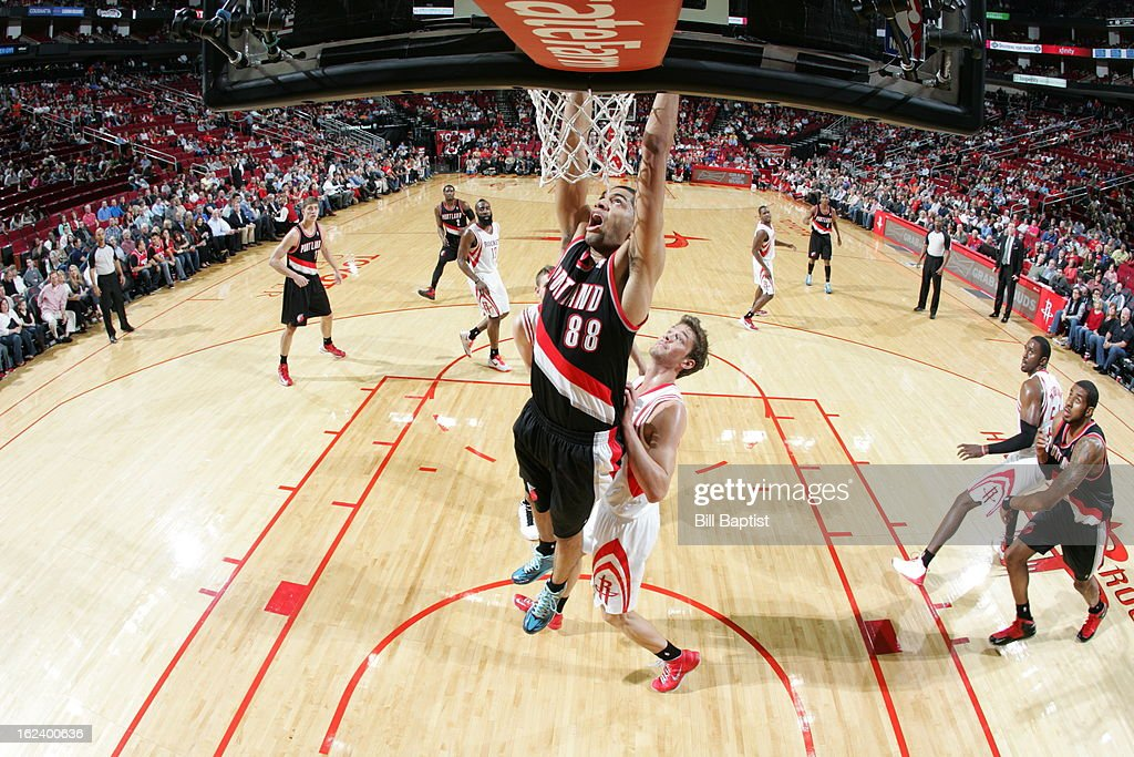 <a gi-track='captionPersonalityLinkClicked' href=/galleries/search?phrase=Nicolas+Batum&family=editorial&specificpeople=3746275 ng-click='$event.stopPropagation()'>Nicolas Batum</a> #88 of the Portland Trail Blazers goes up for the dunk against the Houston Rockets on February 8, 2013 at the Toyota Center in Houston, Texas.