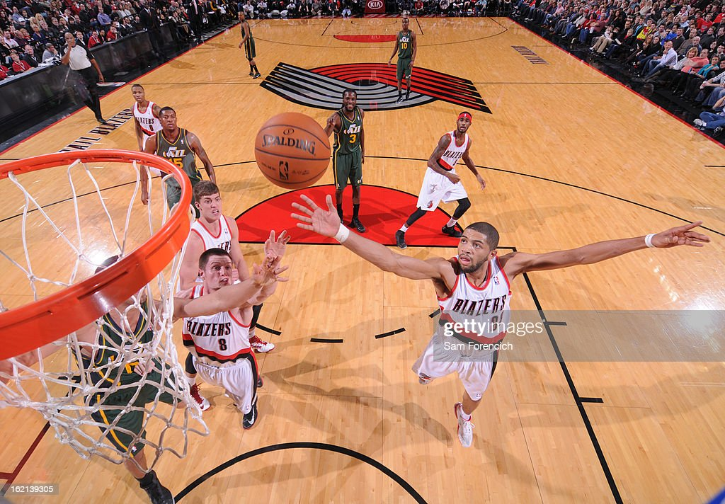<a gi-track='captionPersonalityLinkClicked' href=/galleries/search?phrase=Nicolas+Batum&family=editorial&specificpeople=3746275 ng-click='$event.stopPropagation()'>Nicolas Batum</a> #88 of the Portland Trail Blazers grabs a rebound against the Utah Jazz on February 2, 2013 at the Rose Garden Arena in Portland, Oregon.