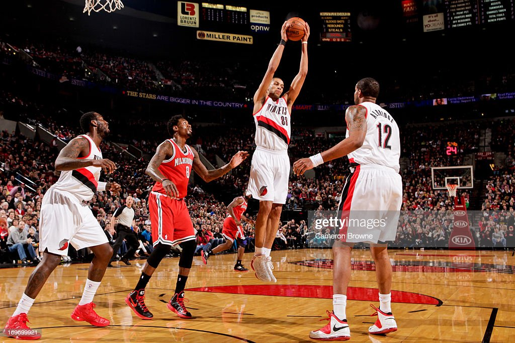 <a gi-track='captionPersonalityLinkClicked' href=/galleries/search?phrase=Nicolas+Batum&family=editorial&specificpeople=3746275 ng-click='$event.stopPropagation()'>Nicolas Batum</a> #88 of the Portland Trail Blazers grabs a rebound against the Milwaukee Bucks on January 19, 2013 at the Rose Garden Arena in Portland, Oregon.
