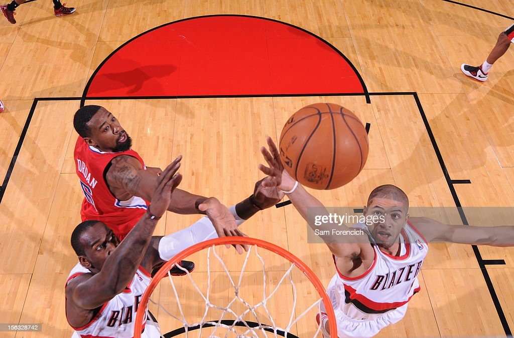 <a gi-track='captionPersonalityLinkClicked' href=/galleries/search?phrase=Nicolas+Batum&family=editorial&specificpeople=3746275 ng-click='$event.stopPropagation()'>Nicolas Batum</a> #88 of the Portland Trail Blazers grabs the rebound against the Los Angeles Clippers on November 8, 2012 at the Rose Garden Arena in Portland, Oregon.