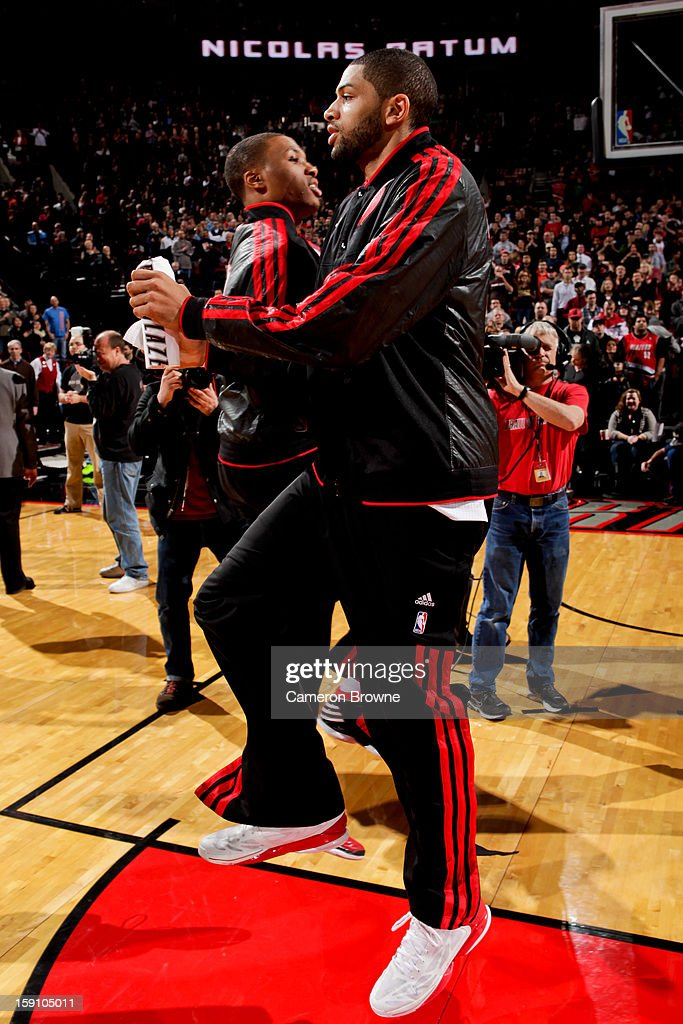 <a gi-track='captionPersonalityLinkClicked' href=/galleries/search?phrase=Nicolas+Batum&family=editorial&specificpeople=3746275 ng-click='$event.stopPropagation()'>Nicolas Batum</a> #88 of the Portland Trail Blazers greets <a gi-track='captionPersonalityLinkClicked' href=/galleries/search?phrase=Damian+Lillard&family=editorial&specificpeople=6598327 ng-click='$event.stopPropagation()'>Damian Lillard</a> #0 before playing against the Orlando Magic on January 7, 2013 at the Rose Garden Arena in Portland, Oregon.