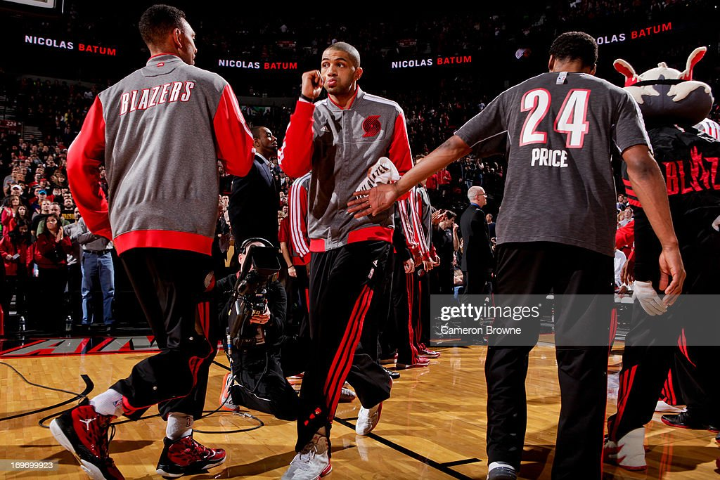 <a gi-track='captionPersonalityLinkClicked' href=/galleries/search?phrase=Nicolas+Batum&family=editorial&specificpeople=3746275 ng-click='$event.stopPropagation()'>Nicolas Batum</a> #88 of the Portland Trail Blazers greets teammates before playing against the Milwaukee Bucks on January 19, 2013 at the Rose Garden Arena in Portland, Oregon.